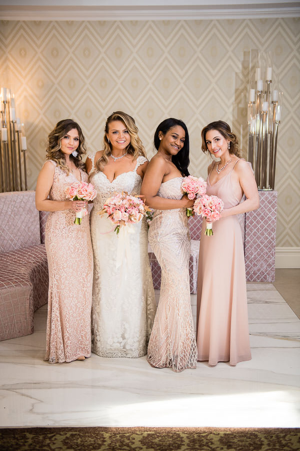 bride and her bridesmaids in light pink dresses at their nyc spring wedding