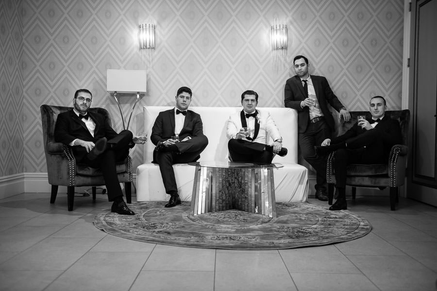 groom and groomsmen sitting high fashion wedding in nyc