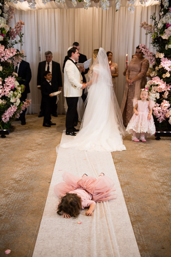 flower girl fell flat face to the ground funny wedding moment during ceremony