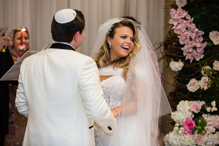 bride laughs during vow exchange