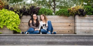lesbian engagement session in new york city gantry plaza state park with puppy