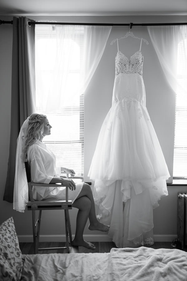 bride getting ready with bridesmaids before her wedding