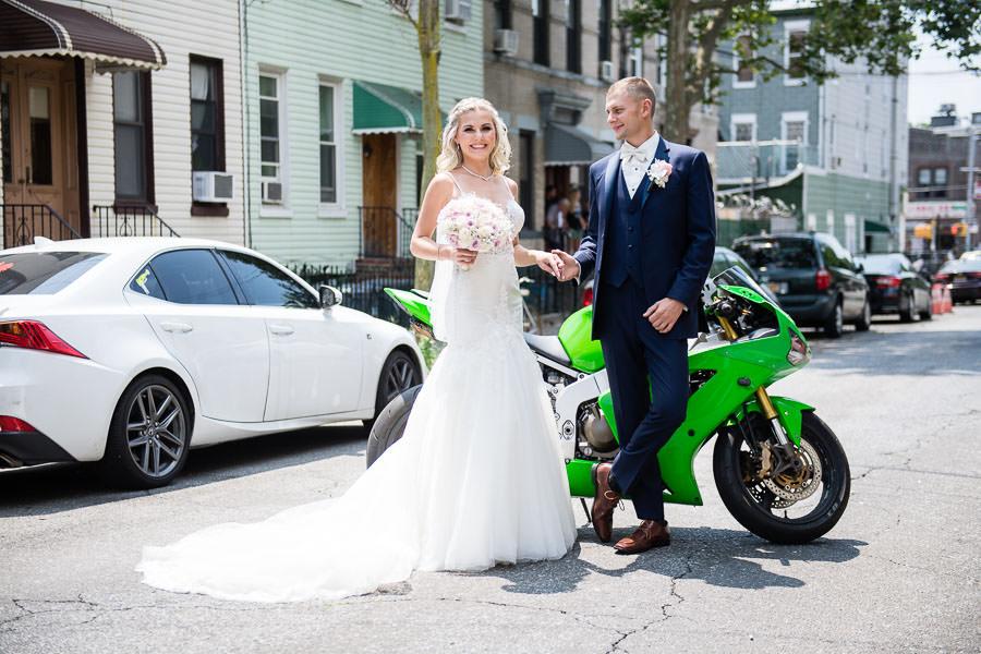 wedding couple poses with green ninja motorcycle