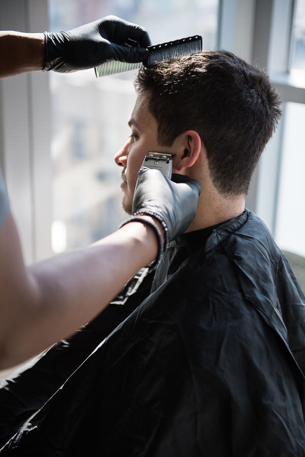 groom getting a hot shave before the wedding