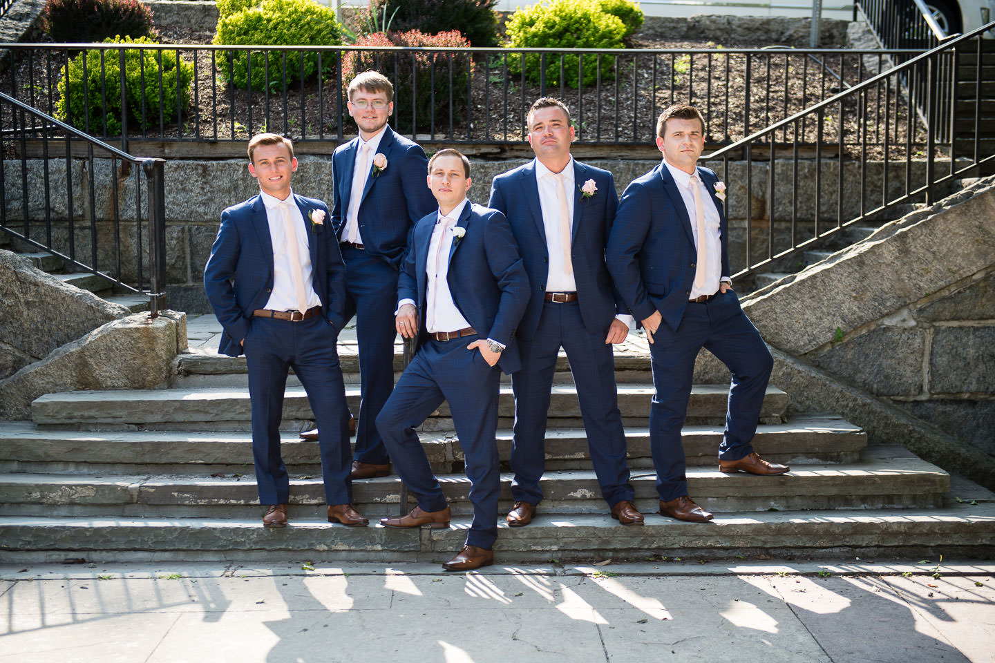 groomsmen at lambert castle during wedding photo session