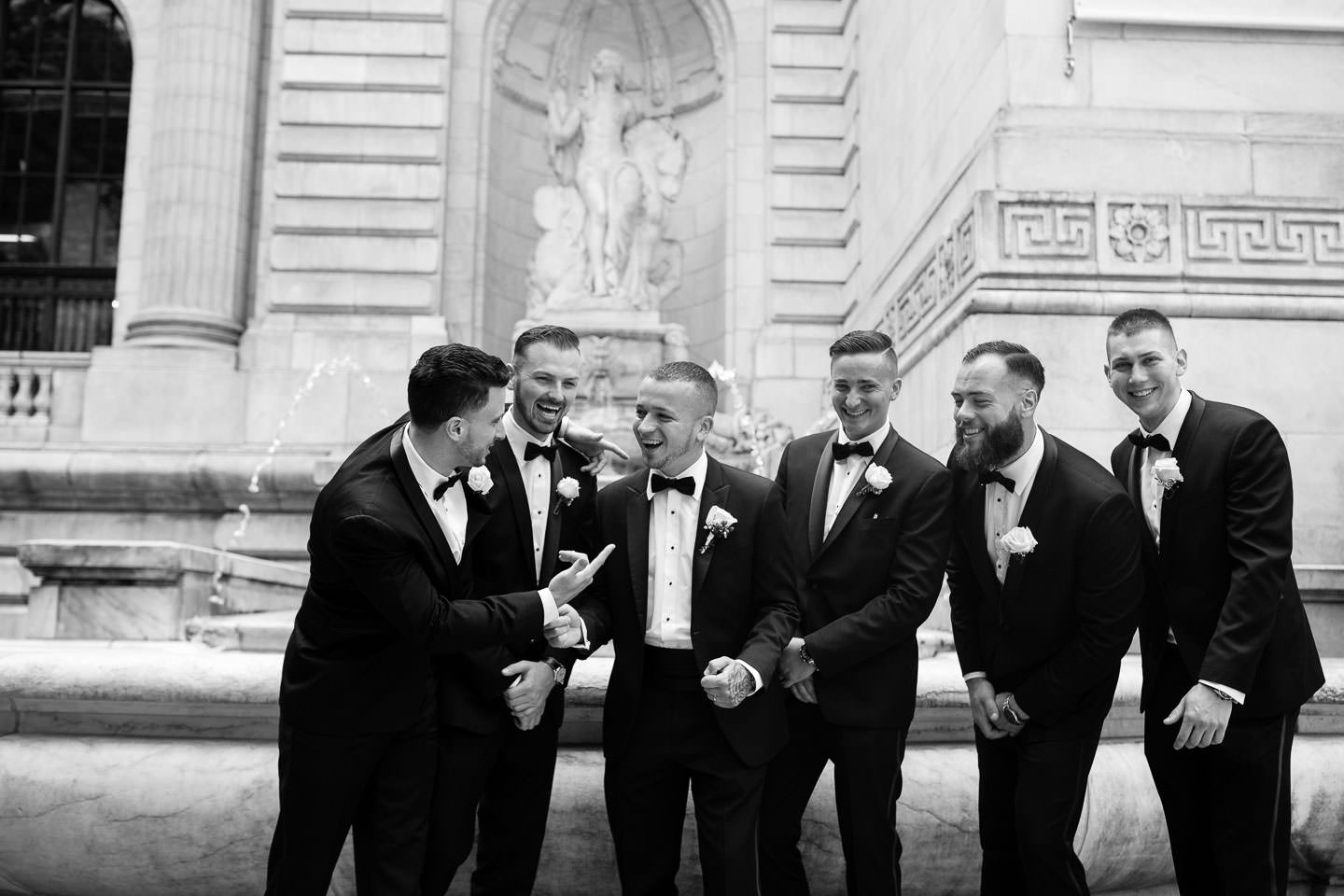 groomsmen at new york public library wedding