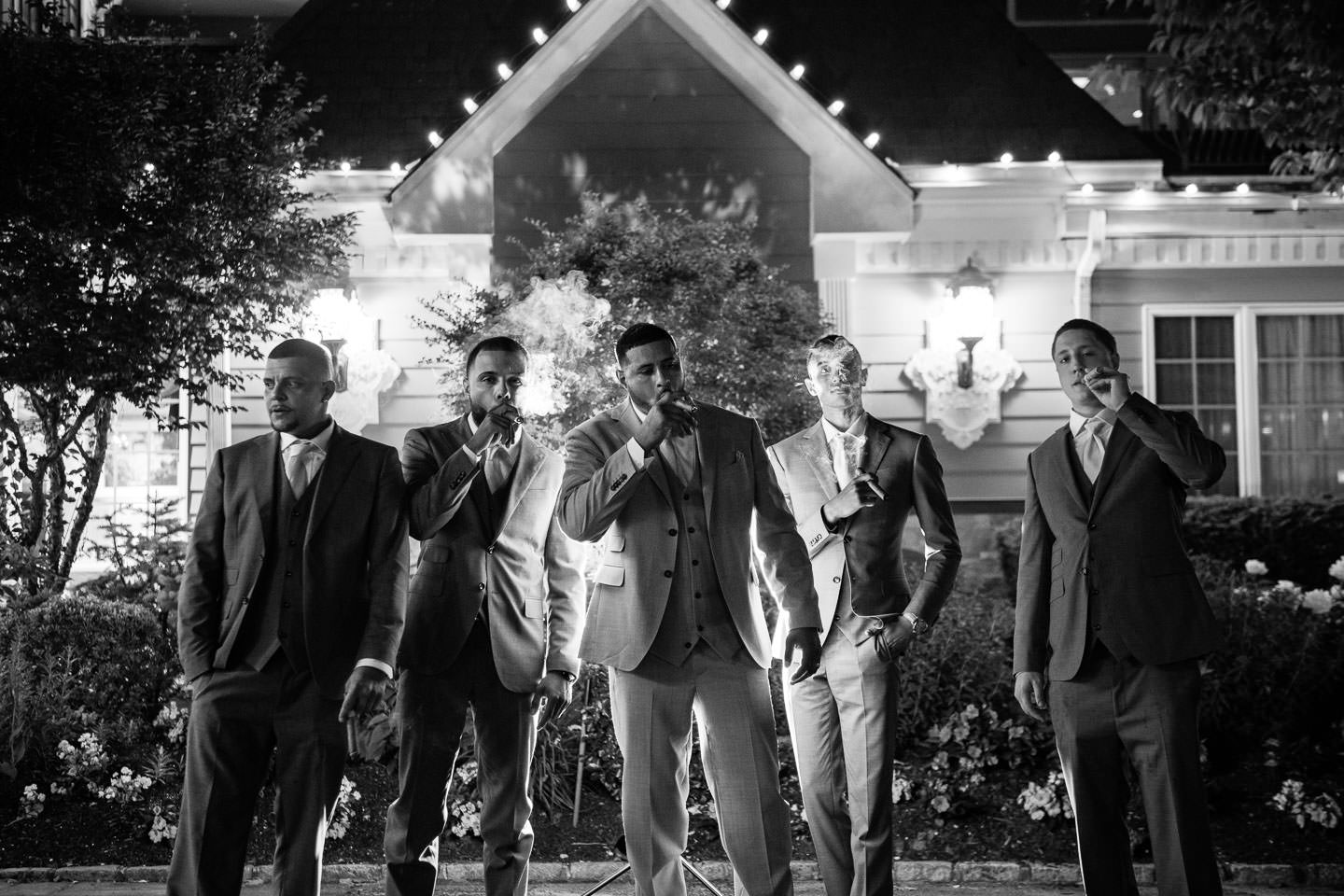 groomsmen cigar photo at wedding at giorgios baiting hollow